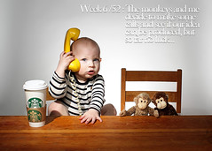Week 6 / 52 : The monkeys and me decide to make some calls and see if our idea can be produced, but so far no luck... (Chris Kryzanek) Tags: baby cup phone starbucks monkeys 52 woodtable 52weeks strobist
