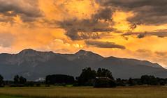 far away (--Conrad-N--) Tags: bavaria bayern sunset mountains clouds house field trees sky
