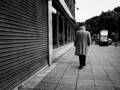 Chasing Pavements (Feldore) Tags: candid big man behind long coat ennui weary belfast street northern ireland irish pavement enigmatic depressed feldore mchugh em1 olympus 17mm 18