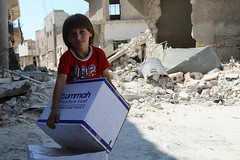 Food aid for a child in devastated Aleppo (Ummah Welfare Trust) Tags: syria levant war poverty hunger children middle east طفل الأطفال بلاد الشام حرب جوع فقر humanitarian humanitarianism islam muslims الإسلام مسلمون