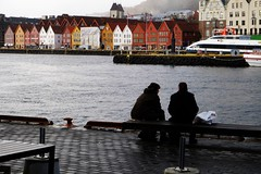 Friends (halifaxlight) Tags: norway bergen bergenfjord bryggen men sitting talking sea city urban ferry colourful winter