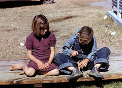 Boy building a model airplane as girl watches (exit78) Tags: barefoot feet girl boy