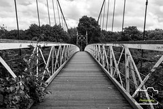 walk bridge (LAJ-Photography) Tags: trail walkway bridge architecture outdoor building truss structure warrington black white trees urban decay clouds sky grafiti