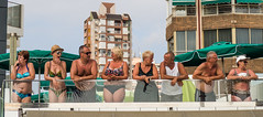 Watching. . (CWhatPhotos) Tags: benidorm spain spanish resort costa blanca photographs photograph pics pictures pic picture image images foto fotos photography artistic cwhatphotos that have which with contain em10 omd olympus esystem four thirds digital camera lens olympusem10 mk ii 43 mft micro seaside holiday september 2016 gay pride gaypride2016 march parade along front promenade color colors colours colour people happy fun times tan tanned men woman group watching watch observe bikini large small breasts