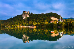 Bled - Early Morning Reflections of Bled Castle (Yen Baet) Tags: city travel vacation cliff lake reflection castle church nature water architecture sunrise island photography dawn town photo twilight ancient europe european cityscape waterfront view postcard hill scenic eu landmark icon tourists slovenia vista bled bluehour picturesque iconic isle waterscape glacial julianalps bledcastle blejskigrad veldes stmartinsparishchurch uppercarniola yenbaet assumptionofmarypilgrimagechurch burgveldes