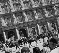 Watching the Changing of the Guard (April.Moulton) Tags: street travel horses blackandwhite building architecture canon europe sweden stockholm candid crowd guard streetphotography palace canon350d guards royalpalace changingoftheguard nationalgeographic candidphotography travelphotography