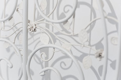 Two Hundred and Twenty One. (evilibby) Tags: light shadow white flower leaves contrast dark leaf bed vines soft shadows vine pale headboard swirl swirls delicate bedframe swirly mybedroom project365 heamm