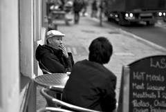 Hot Meals And A Cigarette (Cris Rose) Tags: street leica blackandwhite man menu table 50mm pub bokeh pavement cigarette voigtlander sharp lorry cap m8 f11 nokton