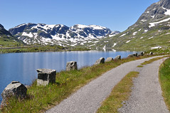 The old road at Haukeliseter, Telemark, Norway. (Grey travel) Tags: road blue summer sky mountain snow water norway day scape telemark gettyimages gi1012