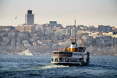 the Boat and the Bosphorus (bass_nroll) Tags: city bridge sea water ferry skyline canon turkey boat seagull istanbul commuting commuters traghetto metropoly 450d