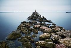 The Seaward road (Jerome Pouysegu) Tags: ocean sea roses costa mer lighthouse pose seaside spain rocks long exposure rosas seashore brava phare rochers jete baie digue longue