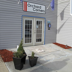 Painting the front door white (Orchard Corners Apartments) Tags: door blue plants paint apartments orchard front renovation mulch corners improvements