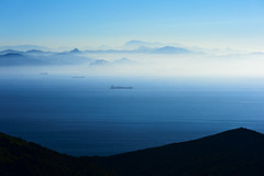 Strait of Gibraltar (Allard Schager) Tags: africa blue winter mist seascape mountains nature water beautiful landscape spain nikon europe december ships surreal blues andalucia morocco cadiz vista mystical andalusia gibraltar atlanticocean meet strait connection marokko mediterraneansea gettyimages connect tarifa spanje 2012 rif pillarsofhercules continents waterscape mistymountains straitofgibraltar theotherside estrechodegibraltar rifmountains strog andalucie d700 nikond700 nikonfx allardone allard1 rifgebergte gateofcharity babelzakat elestrechonaturalpark nikkor70200mmf28vrii fullframepower nikcolorefexpro4 allardschagercom algamasilla