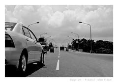 Have to Go a Long way .... (Riduanul Islam Riduan) Tags: road bw white black car self direction aim dhaka conceptual bangladesh concepts