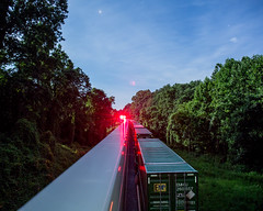 Long exposure of the trailers on 203 blurring past the stopped 214. (bdunn829) Tags: longexposure nightphotography railroad night ns trains nightsky arrowhead 203 norfolksouthern 214 railfanning ns214 ns203 arrowheadvalleyroad