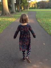Skip to My Lou (enveehaze) Tags: light motion black girl colorful child dress path patterns tights skipping 1131 colorfu 365d