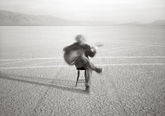 Self with Guitar, Alvord Desert, Oregon (austin granger) Tags: longexposure music blur film oregon alone time guitar song empty tracks playa cracks largeformat chord chords hankwilliams alvorddesert coolwater deardorff austingranger
