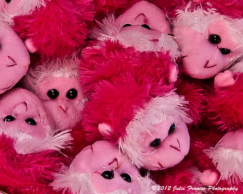 A Barrel Full of pink Plush Monkeys