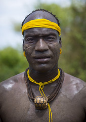 Portrait Of A Bodi Tribe Man, Hana Mursi, Omo Valley, Ethiopia (Eric Lafforgue) Tags: africa portrait people haircut color art beauty vertical proud outside photography necklace clothing fight colorful day serious outdoor traditional culture pride jewelry tribal ornament omovalley colourful tradition ethiopia tribe pastoral ethnic hairstyle struggle bodymodification oneperson headband jewel strenght onepeople determination confidence headwear hornofafrica ethnology bodi omo eastafrica tribesman onepersononly traditionalclothing realpeople colorimage turtleshell lookingatcamera beautify meen waistup africanethnicity pastoralist pastoralism img2313 snnpr bodytransformation oneadult southernnationsnationalitiesandpeoplesregion ethiopianethnicity hanamursi