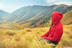 red hoody (.:: Maya ::.) Tags: autumn red woman mountain nature girl woods sitting view meadow bulgaria hoody range  balkan         mayaeye mayakarkalicheva