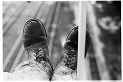 Dad Boots (Matthew Trevithick Photography) Tags: blackandwhite film feet yard cn 35mm scans jasper industrial boots rail railway negative alberta 1970s railyard canadiannational matthewtrevithick terrytrevithick
