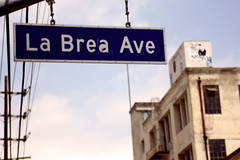 La Brea Ave (See El Photo) Tags: california ca street city blue windows sky urban color building sign digital canon eos rebel photo losangeles wire bluesky wires ave signage hanging telephonepole labrea cityofangels labreaave t1i