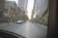 downtown out the steetcar window (Beaulawrence) Tags: street camera summer toronto ontario canada color colour film analog vintage gold lomo lomography downtown king kodak candid ttc grain lofi rangefinder scan retro september negative 400 transit to konica asa streetcar expired sept ont 2012 on c41 c35 sooc