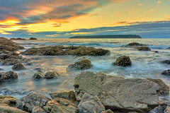 Infinity... [Explore] (Ankit_) Tags: longexposure sunset newzealand sky seascape beach nature canon landscape bay coast rocks flickr nz wellington redrocks northisland coastline southcoast hdr cpl topaz porirua titahibay nd8 eos450d 1855kitlens 450d ihdr
