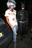 Liam Payne of One Direction dressed as Batman, with a friend