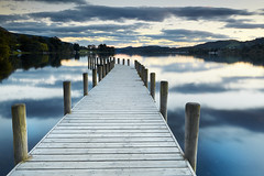 A World Away (AndyV12) Tags: longexposure blue autumn orange lake water clouds evening wooden boards sailing jetty calm mooring bluebird coniston piles thelakedistrict summertimeuk welcomeuk