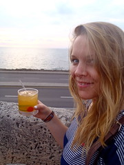 Drinks and the Sea! (The Travelin Chicks) Tags: ocean trip travel sunset sea vacation sky southamerica girl smile bar restaurant seaside cafe colombia chelsea chica drink drinking culture chick adventure backpacking drinks blonde tropical booze traveling cocktails backpacker cartagena cartegena cafedelmar traveler whiskeysour mixeddrink traveladventure travelinchucks chelseaosborn travelinchicks