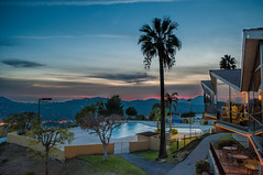 Los Angeles Sunset (Michelle M. Kwong) Tags: sunset sky tree pool silhouette landscape la losangeles scenery colorful view balcony palmtree