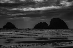 Three rocks, black day (Dave Arnold Photo) Tags: ocean usa storm wet rain weather rock oregon island coast three us photo seaside pacific image or wildlife tide arnold picture wave arches pic national photograph oceanside haystack oregoncoast westcoast ore tidal refuge coasthighway davearnold centraloregoncoast cetralcoast davearnoldphotocom