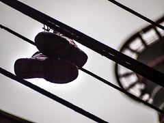 shoes on a wire near woodwards epl1-raw-vancouver-20130124-P1244897.jpg (roland) Tags: vancouver wire shoes rolandtanglaophoto w2 woodwards shoesonawire shoefiti olympus40150mm highflungsoles olympusepl1
