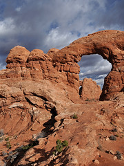 Grand - Sunny Side Turret Arch (Drriss & Marrionn) Tags: travel roadtrip lasal utah usa landscape outdoor blueskies cloud clouds sky skies rock mountain mountains canyon mountainside sandstone nature red crag cliff archesnationalpark moab rockformation arch naturalarch turretarch