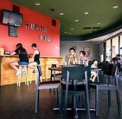 Tasty Cup (spanjavan) Tags: street bobatea bubbletea boba chairs table customers people tastycup iphone public