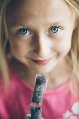 Otter Pop. (aamith) Tags: girl otterpop eyes kids portrait carlzeiss 135mm dof bokeh makeportraits portraiture popsicle