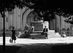 Reading (Crisp-13) Tags: black white monochrome street scene candid people winchester hampshire cathedral war memorial man lady dress suit