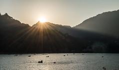 sun-kissed (eyenamic) Tags: lake nainital uttarakhand hills mountains sunset sunburst india light silhouette dusk nikon d5100 serene outdoor boats himalaya ray