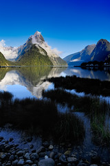 Milford Sound (robertdownie) Tags: fog morning water cold island blue rain boats mountain cloud peak clear new sound wet gloom fjord refelction south maori milford zealand mitre mist nz piopiotahi te rahotu wahipounamu