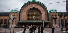 2016 - Baltic Cruise - Helsinki - Central Station (Ted's photos - For Me & You) Tags: 2016 cropped tedmcgrath tedsphotos vignetting helsinki helsinkifinland finland helsinkicentralstation helsinkirailwaystation people peopleandpaths railing crosswalk elielsaarinen backpack