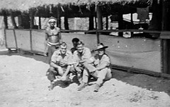 2/4th Australian Anti-Malarial Control Unit Cpl Tom Beazley with mates George Dobner & Bill Angwin with a few of the native boys outside their hut in Port Moresby, New Guinea (aussiejeff) Tags: bw soldier army war control australia spray mosquito ww2 24 amu 1944 newguinea unit ddt malaria 6thdivision 2ndaif billangwin tombeazley georgedobner