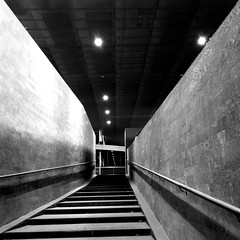 Stazione Tiburtina 2 (SS) Tags: city light italy white black building lines composition square mood dof view angle pov walk perspective tunnel september framing stazione bianco nero lazio tiburtina pendolare atmophere iphone4