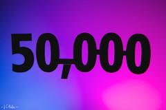 Milestone (323/365) (Jchales.co.uk) Tags: pink blue silhouette canon project flickr day colours thankyou cyan days views font 365 milestone 50000 laminate 323 fushia triggers ettl strobist efs1755mmf28isusm 580exii 430exii yongnuo yn622