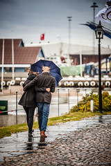 Couple vs Autumn rain (Michael Wahlgren) Tags: city blue autumn people green leaves rain stairs scott michael town photo leaf couple stair wind sweden walk small sigma windy worldwide sverige vs fortress hst varberg badweather 2012 70200mm kelby halland thegalaxy wahlgren canoneos5dmarkii