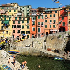 Riomaggiore quay framed among typical coloured buildings (B℮n) Tags: world ocean park pink flowers blue houses sea summer vacation sky orange sun sunlight holiday tower heritage water colors beautiful weather train buildings coast boat high warm mediterranean italia sailing ship torre gulf hiking path five character liguria shoreline hike case cliffs lovers quay historic bougainvillea unesco via vineyards national wharf terre sail botanic overlooking quaint inspire incredible viewpoint picturesque coloured topf100 cinque adriatic riomaggiore italianriviera torri yellew dellamore 100faves 50faves guardiolas