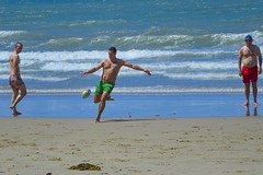 Beach Project - Go Ball! (Julie Byrnes) Tags: beachproject juliebyrnes australiaqueenslandfootballkickingcandidbeachsand
