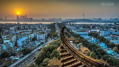 Wuhan city at sunset (Andrea Rapisarda) Tags: china city bridge sunset panorama sun streets skyline river landscape town nikon tramonto torre view ngc location ponte panoramica vista 23 yangtze wuhan sole 169 strade hdr cina hubei nationalgeographic d800 pagode tempio  contrasti contrasto yellowcranetower panoramicview    grattacieli   urbanshots nohdr fiumeazzurro pagodacinese nikon2470mmf28 nuovoemoderno oldandnewchina