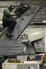 A Sailor works on an MH-60S Sea Hawk. (Official U.S. Navy Imagery) Tags: heritage america liberty freedom commerce unitedstates military navy sailors fast worldwide tradition usnavy protect deployed flexible onwatch beready defendfreedom warfighters nmcs chinfo us5thfleetareaofresponsibility sealanes warfighting preservepeace deteraggression operateforward warfightingfirst navymediacontentservice