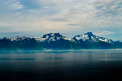 Misty Alaskan Coast (Butch Osborne) Tags: ocean blue sea sky mist mountain snow reflection nature water alaska clouds reflections landscape awesome mystical wilderness